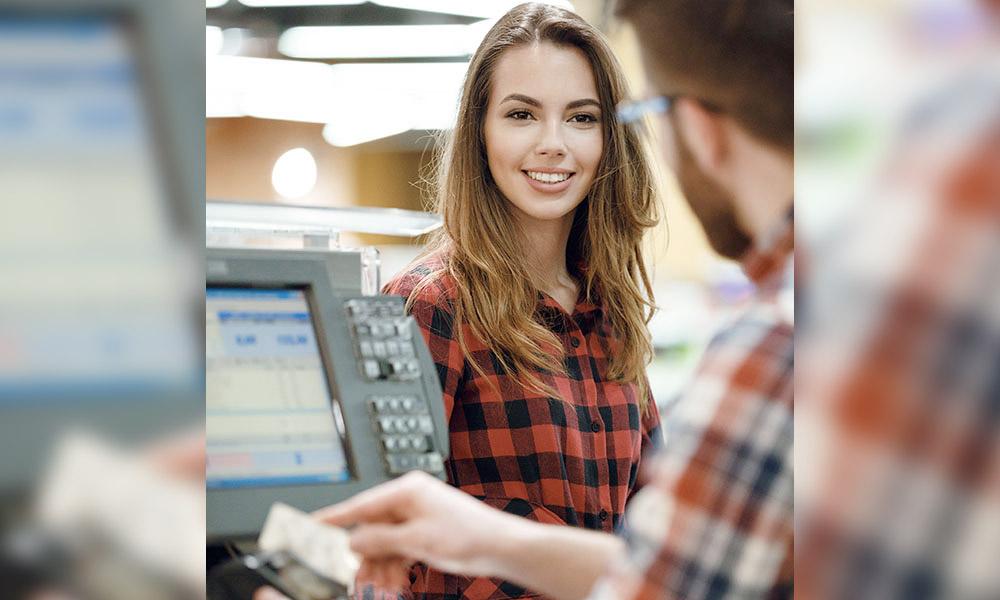 Woman pays at till